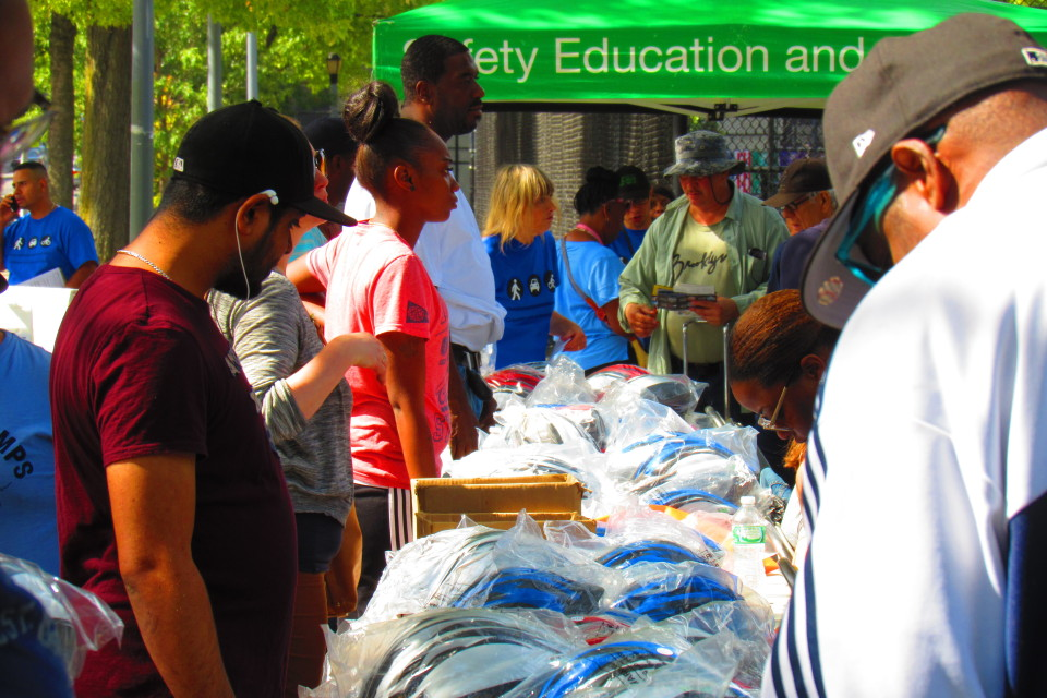 NYC DOT provided hundreds of helmets to give out to residents of BedStuy.