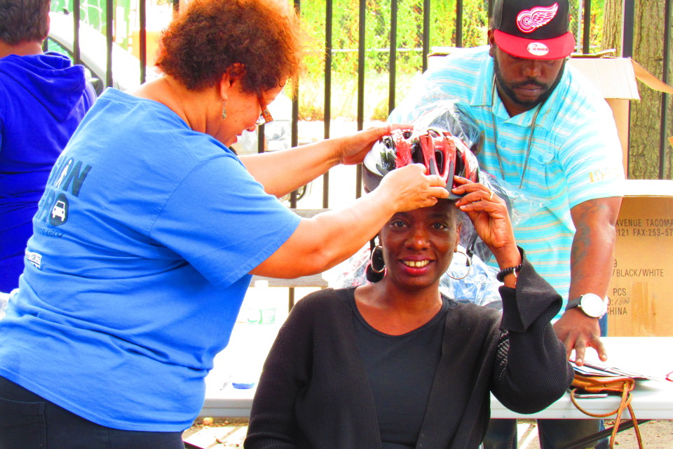 Tracey Capers of Restoration sits for a helmet fitting.