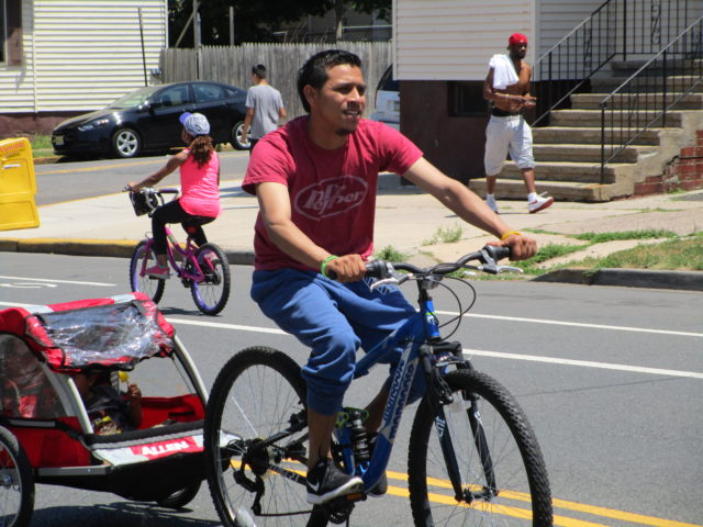 Latino man with bike trailer