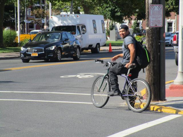 Latino man bike lane