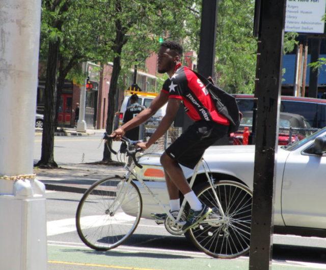 black man on bike