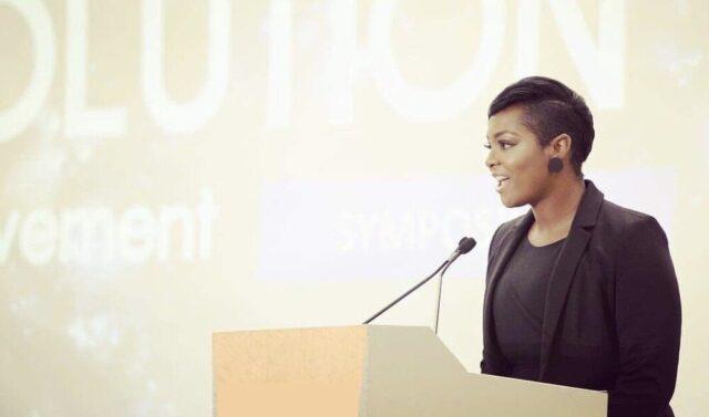 Dr. Destiny Thomas speaking at a podium